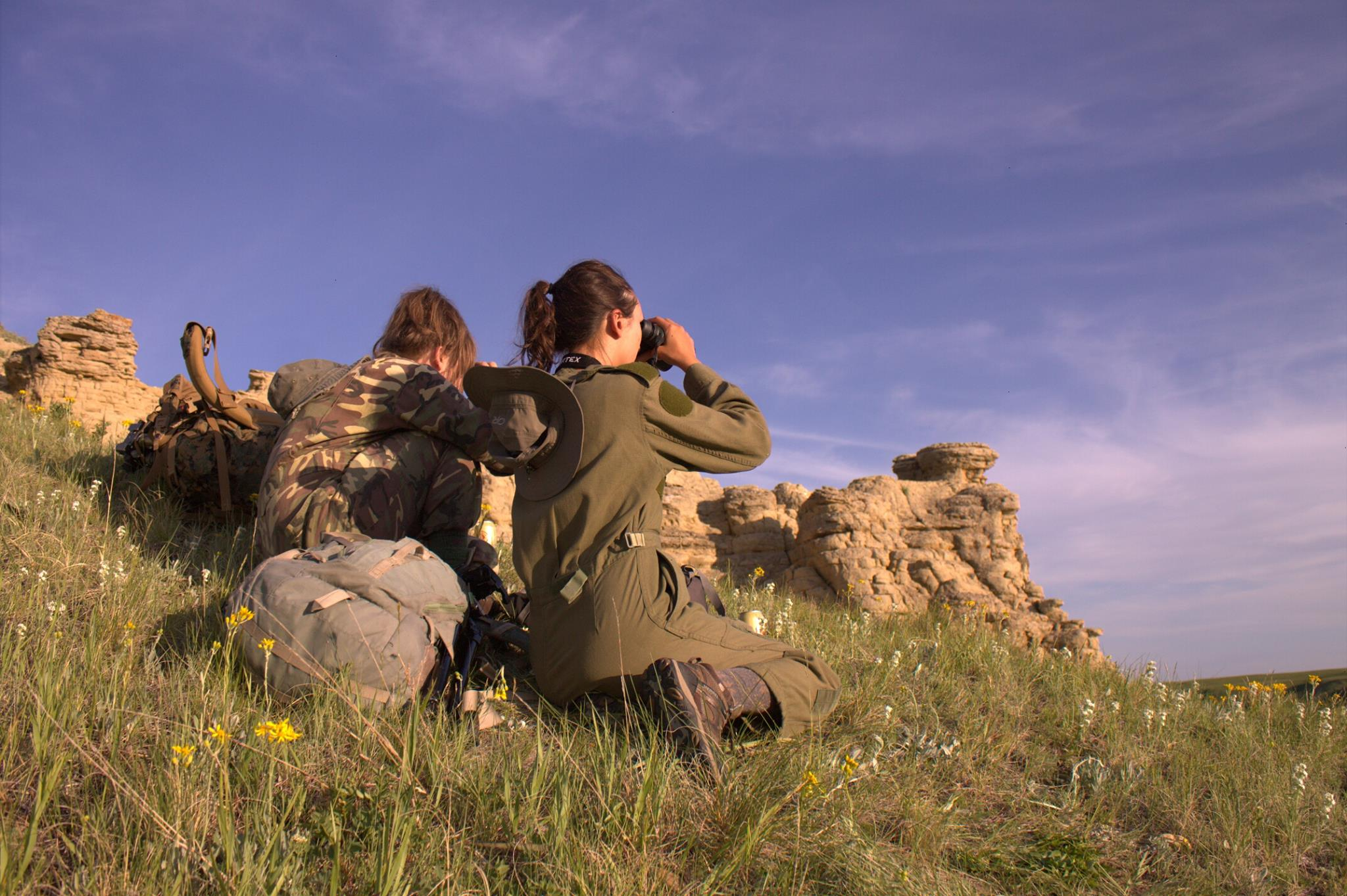 Cora Anne Romanow (left) and Rebecca Carter look for animals during their fieldwork.