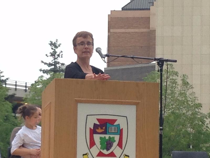 President Annette Trimbee speaks at start of the Habitat for Humanity build