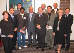 (photo Left to Right, Susan Roberts, Scotiabank, Tom Bryk, Cambrian Credit Union, Glen Kowalchuk, Student, Muuxi Adam, Student, Bob Kozminski, Campaign Chair, Lloyd Axworthy, University President Kirk Stanley, Windsor Masonic Lodge No. 38, Steve Farkas, Scotiabank, Doug Andrews, McLean Budden, Priscilla Boucher, Assiniboine Credit Union, Andy Dutfield, Lafarge Canada)