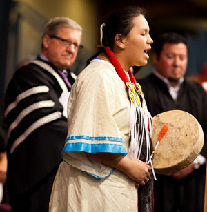 Dr. Lloyd Axworthy, President and Vice-Chancellor, University of Winnipeg with student Jasmine Parisian, at Autumn Convocation 2011.