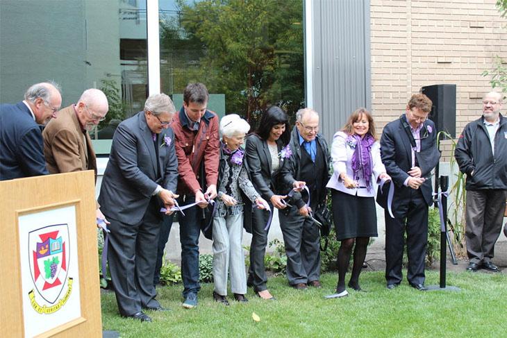 Ribbon cutting at the official opening of Babs Asper Lilac Garden on UWinnipeg campus