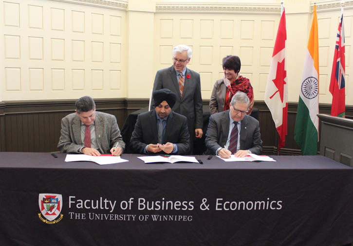 Photo: (front L to R) Dr. Neil Besner, VP Academic and International, UWinnipeg; Hardev Sandhu, President India Assoc, of Manitoba; Dr, Lloyd Axworthy, President and Vice-Chancellor, UWinnipeg sign MOU; (back) Manitoba Premier Greg Selinger; Dr. Sylvie Albert, Dean Business and Economics, UWinnipeg.