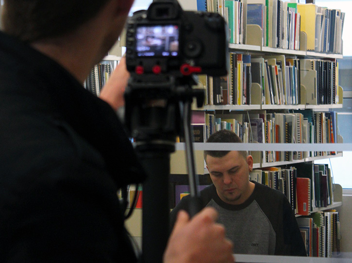 Carl Balan reads during a video shoot for his student profile to air during the Indspire Awards