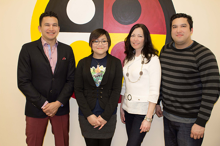 Host Wab Kinew poses with winner Diandre Thomas-Hart, and pitch competition judges Jodi Moskal and Karl Zadnik.