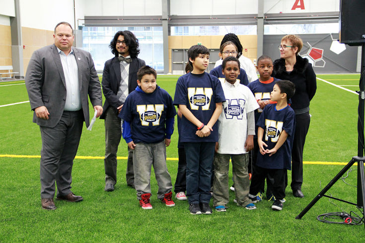 Wade Miller, Chino Argueta, children from John M King School and Annette Trimbee launch Winnipeg Youth Football Club