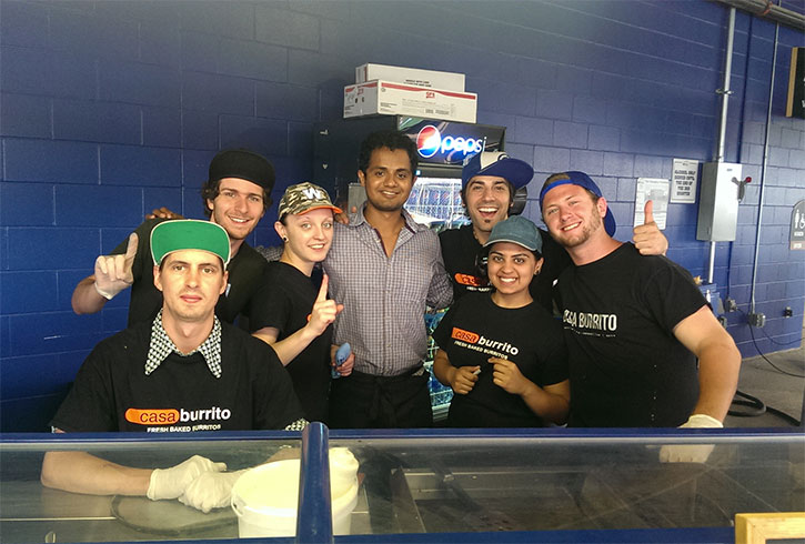 Vinay Iyer (centre) with staff from Casa Burrito