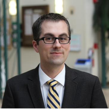 Dr. Justin Friesen