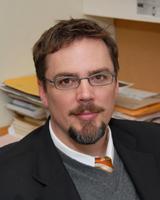 Dr. Adam Muller