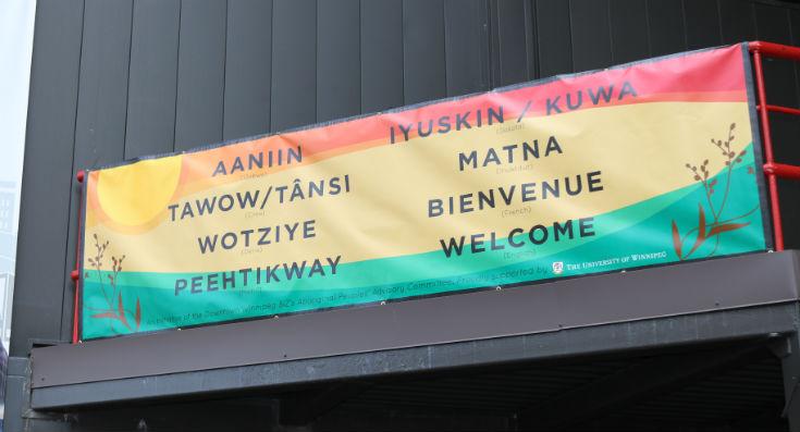 Indigenous language banner hangs at UWinnipeg entrance