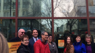 Annette Trimbee helps unveil decal, April 18, photo by Downtown BIZ