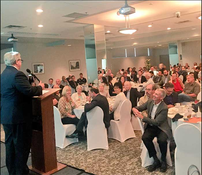 Dr. Lloyd Axworthy addresses attendees at the luncheon on July 12th. Photo (C) Kevin Chief