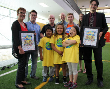 Annette Trimbee (l) and Kevin Lamoureux(r) with Adventure Kids staff photo