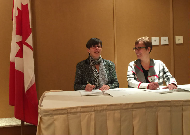 Andrea Lyon, Deputy Minister (Agriculture and Agri-food) and champion of the University of Winnipeg; and Dr. Annette Trimbee, President and Vice-Chancellor, UWinnipeg, sign MOU, Tuesday, November 22, 2016. staff photo