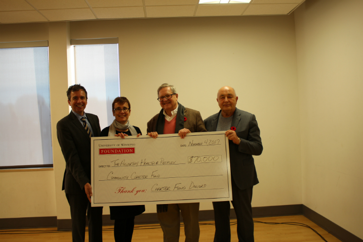 Brian Daly, Dr. Annette Trimbee, Dr. Lloyd Axworthy, and Joe Bova at a donation presentation in November 2016, ©UWinnipeg