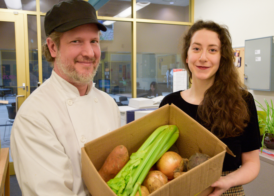 Diversity Chef de Cuisine (Main Campus) John Delaat, left, and UWSA Vice-President Student Affairs Laura Garinger show off the offerings in a February Food Box. ©UWinnipeg