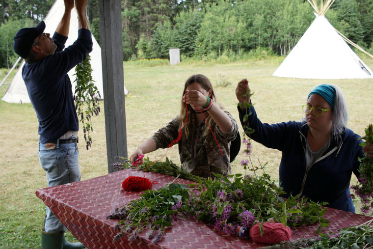 Students prepare and dry medicine Aug 2017 – photo by student Donna Kurt