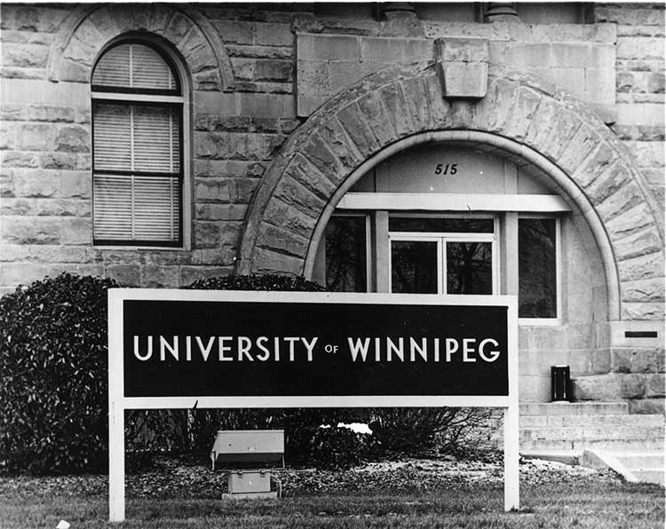 Archival photo of Wesley Hall steps and university sign
