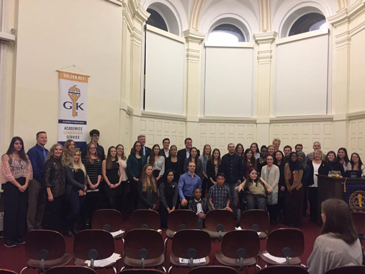 Group of people at the 2017 Golden Key new member recognition event. Photo credit: Jace Turner