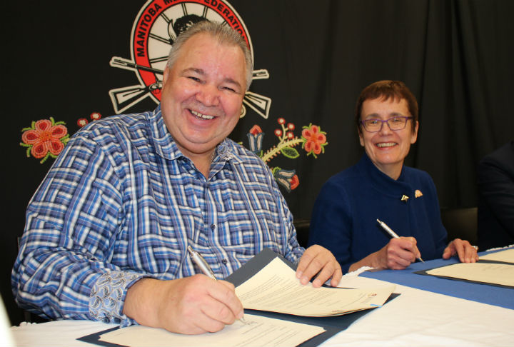 David Chartrand and Annette Trimbee sign MOU - staff photo