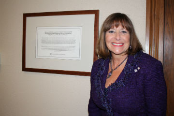 Gail Asper with plaque