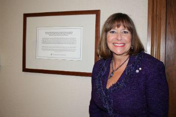 Gail Asper with plaque