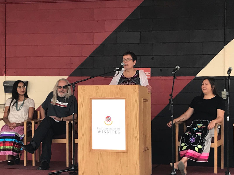 Dr. Annette Trimbee speaks at mural unveiling