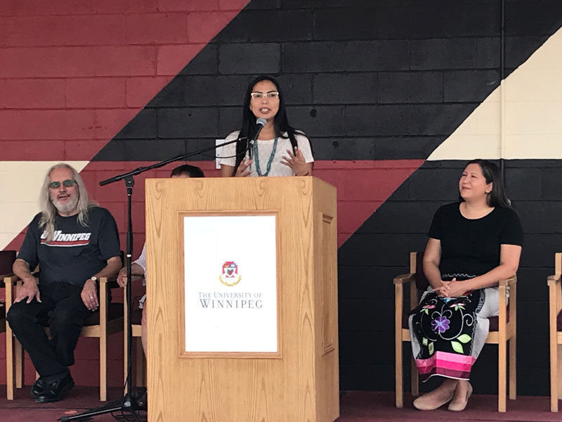 Angeline Nelson speaks at mural unveiling