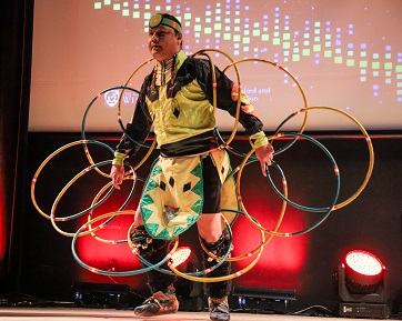Brian Clyne, a member of the Peguis First Nation and an award-winning hoop and traditional dancer performs the opening act at UWinnipeg's eighth annual PACE Cultural Evening.