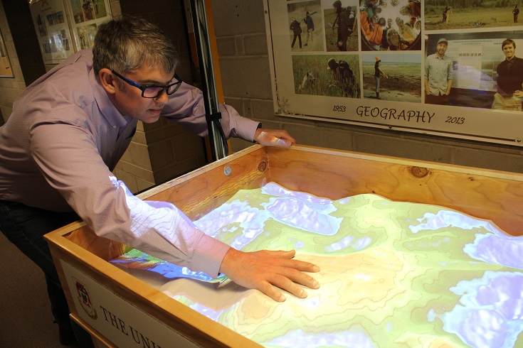 Dr. Christopher Storie demonstrates AR virtual sandbox