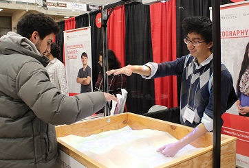Student demonstrates AR Sandbox