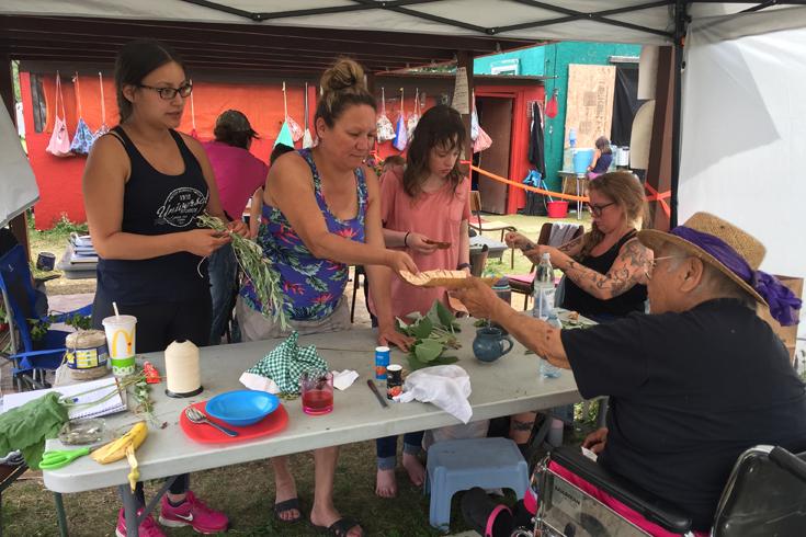 Elder Stella Blackbird Teachings Medicine bundling to UWinnipeg students