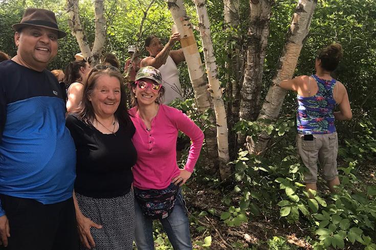 Shailesh Shukla, Audrey Bird and Tonya Gray while harvesting
