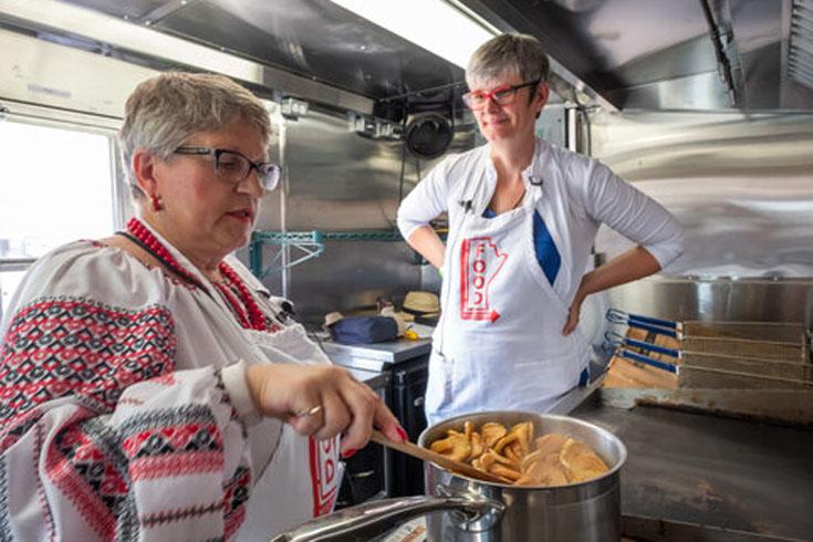 Dr. Janis Thiessen interviews Linda Hunter at National Ukrainian Festival in Dauphin.