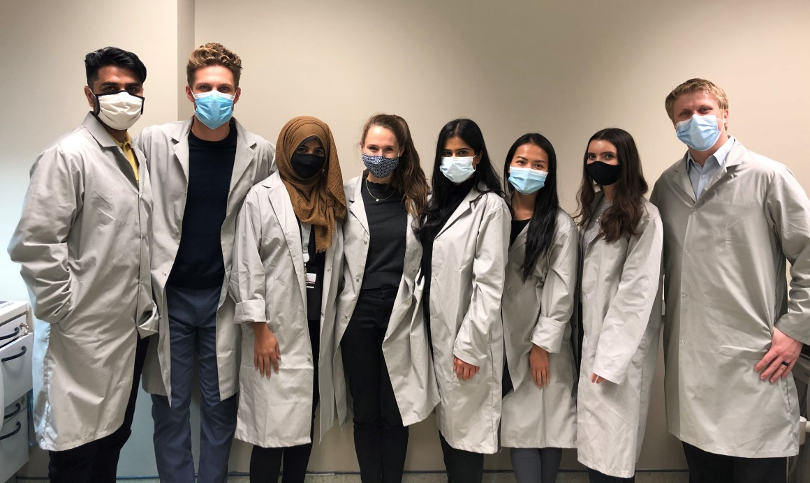 science students in lab coats.